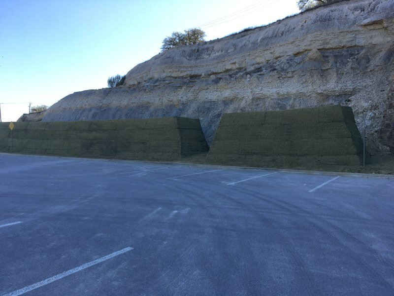 Parking lot protection with rockfall embankment